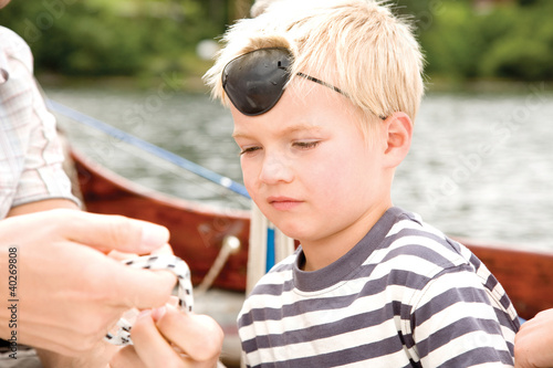 Boy wearing eye patch