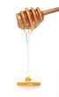 Honey dripping from a wooden spoon