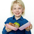 Cute girl shows her sandwich eaten during break