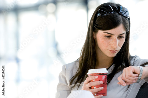 Young woman looking at wristwatch