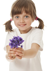 little girl giving a bouquet of violets
