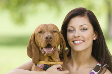 Young woman with dog, smiling