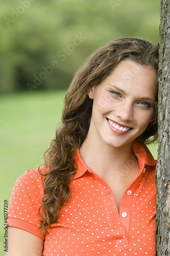 Young woman smiling, portrait