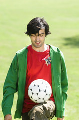 Young man playing Keepy Uppy