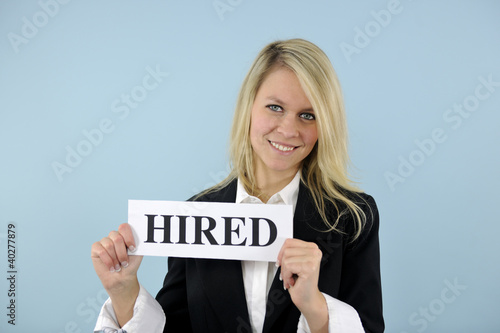 young busineswoman holding hired sign