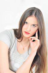 studio portrait of beautiful brunette isolated