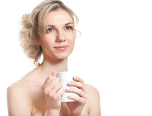 Young blond woman is drinking tea
