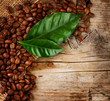 Coffee Border design. Beans and Leaf over Wood Background