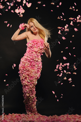 beautiful woman in dress of rose petals