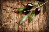 Fototapety Olives over Old Wood Background