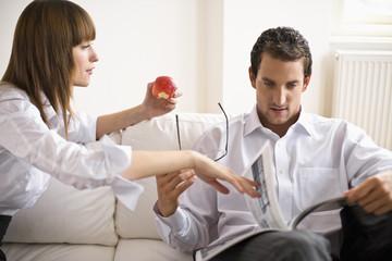 Mid adult couple sitting on sofa