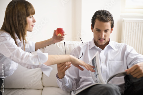Mid adult couple sitting on sofa