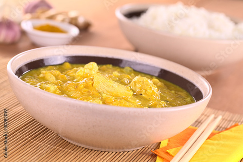 Chicken-mango curry with rice in the back