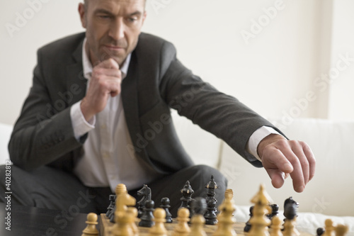 Businessman playing chess