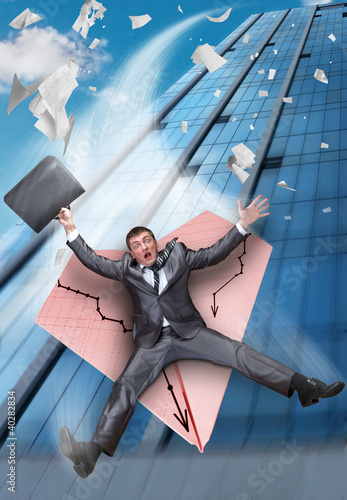 Businessman falling on paper airplane