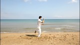 Man practicing Tai Chi  on the beach