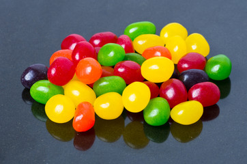 Jelly beans on glossy black