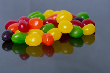 Assorted Jelly Beans on glossy black