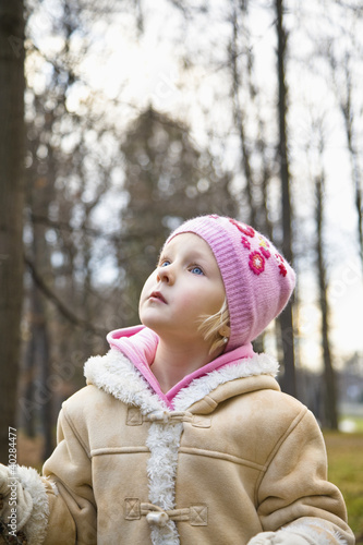 Girl wearing knit hat, looking up