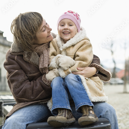 Mother with daughter smiling