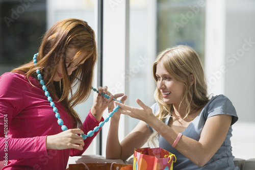 Young women looking at beads