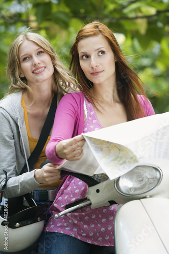Young women holding map