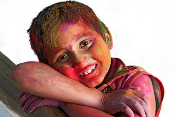 Close up face_young boy_Holi_smiling colors_white BG
