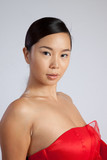 southeast Asian woman in red dress, looking thoughtful poster