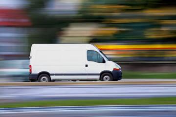 Blur white van  panning and move