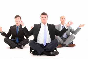 Businessmen meditating on white