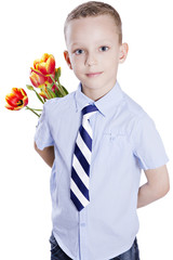 boy with tulips behind his back
