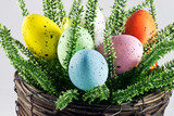 Dyed easter eggs in wicker pot poster