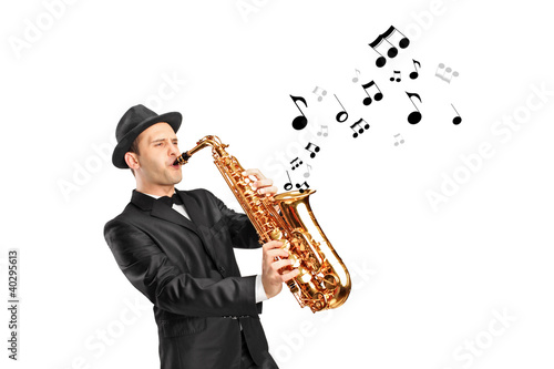A man playing on saxophone and notes coming out