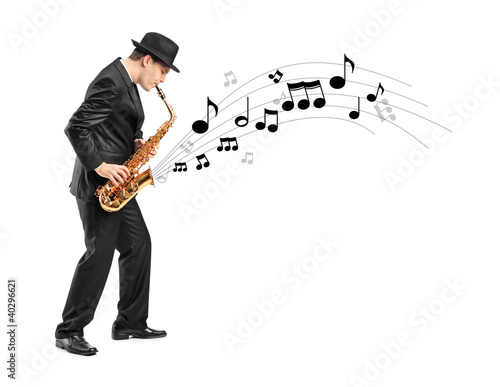 Full length portrait of a man playing on saxophone and notes com