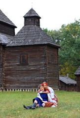 Two female friends in Ukrainian costumes spending time together