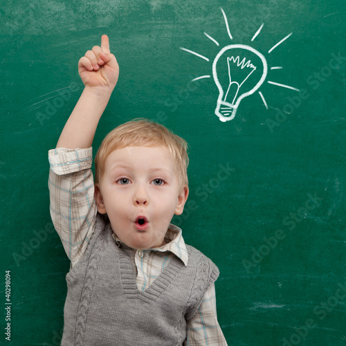 Cheerful smiling child at the blackboard. - 40298094