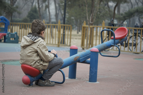 Lonely Child on Seasaw - 40298475