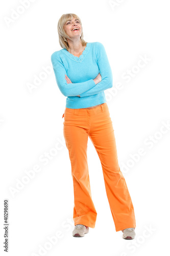 Full length portrait of laughing middle age woman