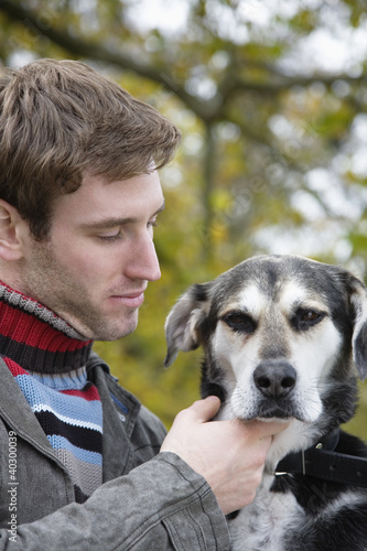 Young man with dog, close-up