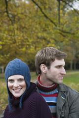 Young couple smiling, close-up, portrait