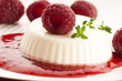 Vanilla panna cotta with berry sauce