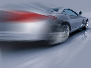 Silver sports car in motion