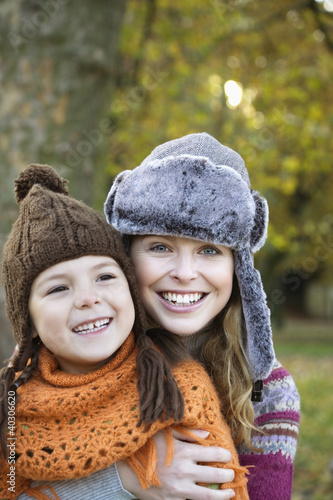 Mother with daughter, smiling, portrait