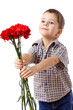 Smiling boy stretches forward a bouquet