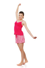 Young teen woman in pink pajamas