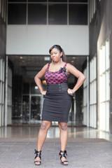 Woman posing akimbo