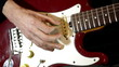Male hands play on electric guitar