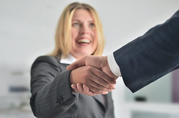 Business women handshake to seal a deal
