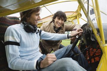 Friends sitting in airplane