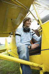 Young man sitting in airplane